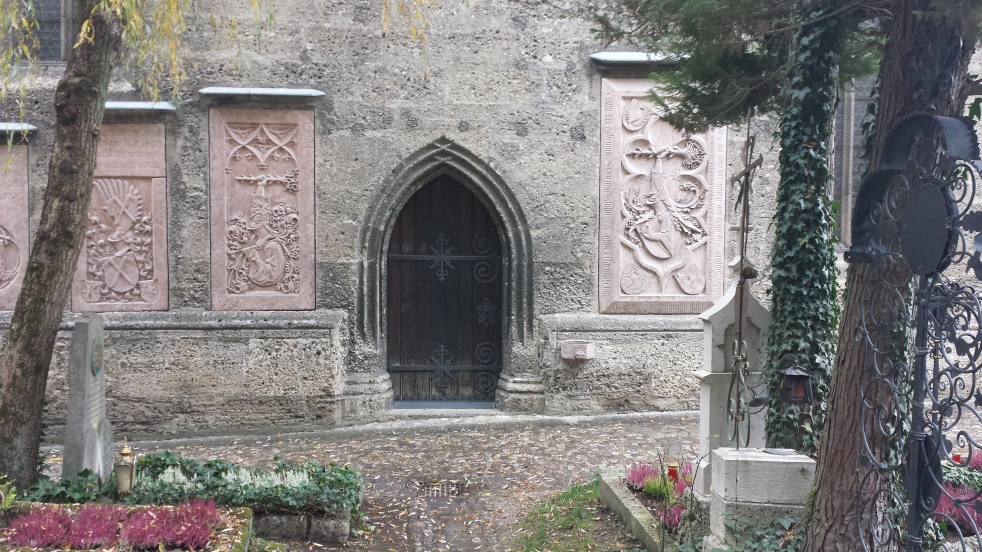 Gothic door in the side of a stone church